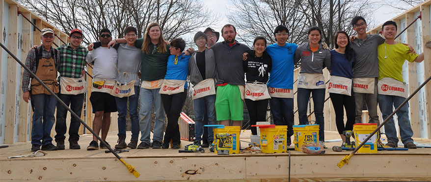 picture of Habitat for Humanity JHU students building a house