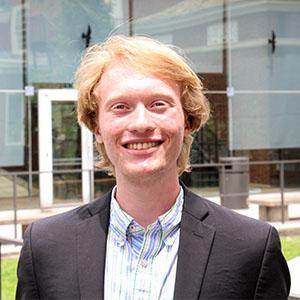 headshot picture of Evan Drukker-Schardl