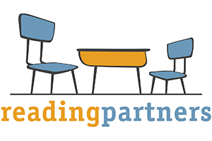 Reading Partners logo with two chairs and desk.