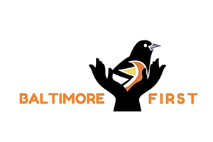 Baltimore First logo, picture of Baltimore Oriole with 2 hands around it