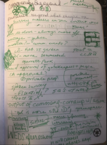 notebook with notes written in green ink