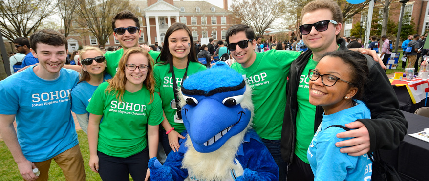 Students from SoHOP post for a photo with the Blue Jay
