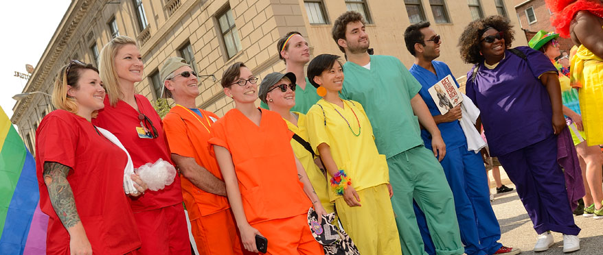 Students wearing rainbow-colored scrubs during Baltimore's PRIDE parade.