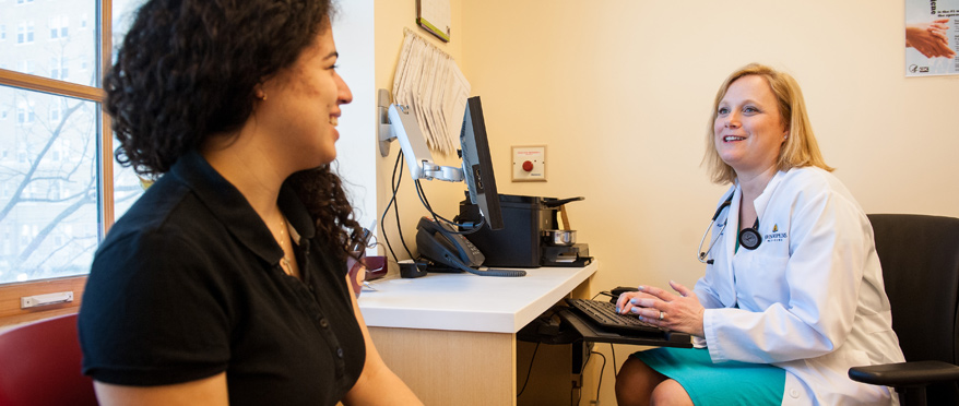 A student speaks with a medical provider in the Student Health and Wellness Center