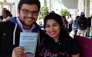 Students holding Neighborhood Open House brochure.