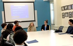 Students listen to a panel discussion during the Second-Year Summit.