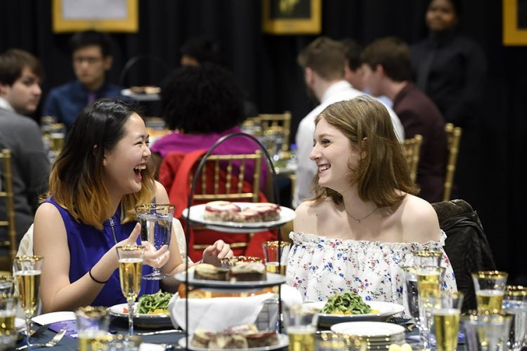 Two students laughing together at the annual First-Year Banquet.