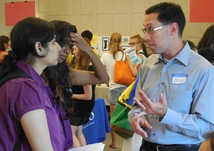 Employer speaking with students at fair