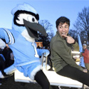 Student riding seesaw with Blue Jay