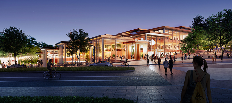 External view of proposed Student Center design at dusk with students walking towards the building.