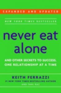 "Book cover that reads, ""Never Eat Alone""."